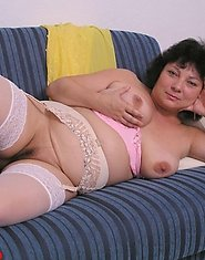 Kinky mature fatty posing in pink lingerie