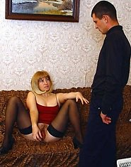 A mature woman in black stockings does blowjob