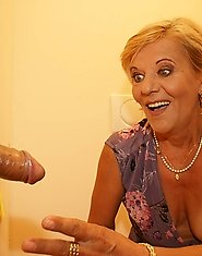 She sucks and fucks that big cock through the hole