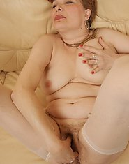 This big mature slut loves to get wet