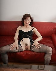 naughty mature slut playing on her couch