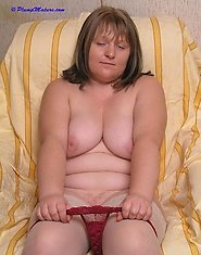 Plump mature woman playing with dildo