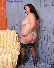 Plump in black stockings shows her body