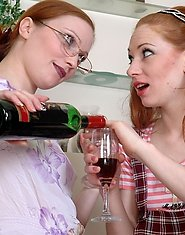 Fiery mature gal makes a filly drink a little before strap-on entertainment
