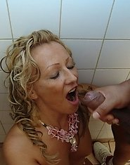 classy mature cunt getting cum on her face in the public bathroom
