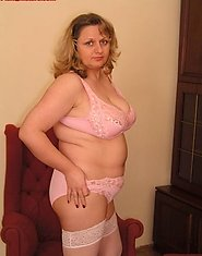 Plump mature blonde in white stockings