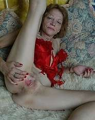 XXX granny in red spreads pussy open for business