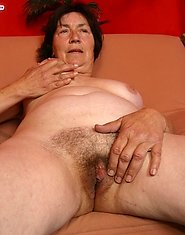 Plump granny plays with her wet unshaven snatch