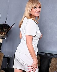 Office cougar Jessica Sexxxton removes her business suit revealing her bra and panties